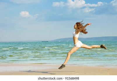 Young girl making exercise on the beach