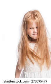 Young girl making a funny face with lots of hair in studio on white background.