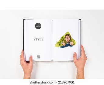 Young girl making Ok sign printed on book