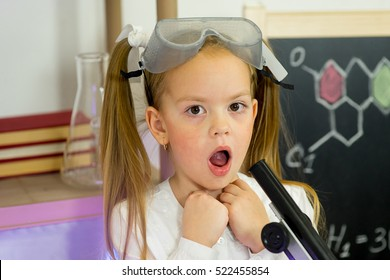 young girl making science experiments