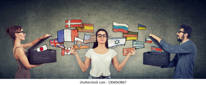 Young girl meditating learning different languages being exposed to different cultures by man and woman with opened boxes and international flags flying away