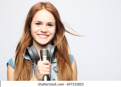 young girl with microphone sings