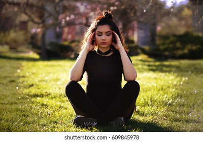 Young Girl With Migraine. Outdoor depressed woman