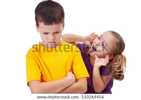 young girl mocking angry boy isolated stock photo edit now