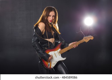 young girl model in an image of a rock star with a guitar Vintage