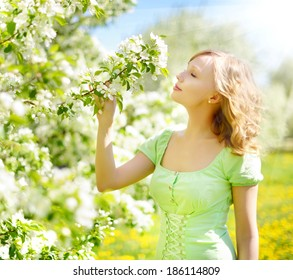 Young girl near the apple tree. background apple tree