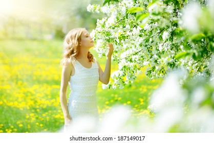 Young girl near the apple tree. light background