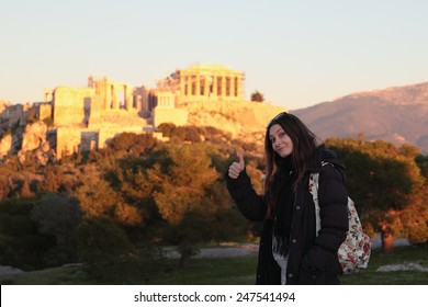 Young girl near firer sunset acropolis.Student in Athens,Greece.