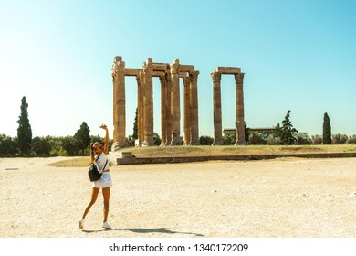 young girl near the ruins of ancient Greece