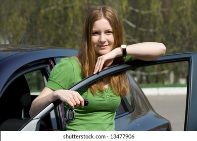 The young girl with the new car