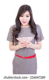 young girl in office clothes hold money on white background