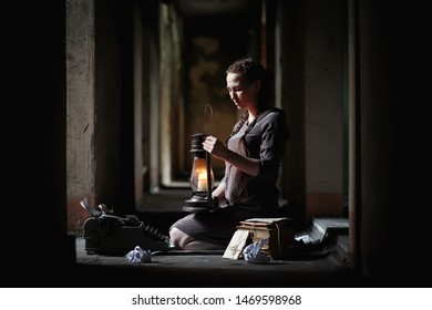 A young girl with old books in the old house
