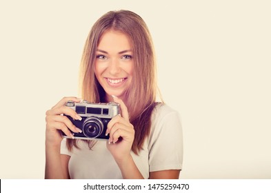 young girl with old camera vintage style