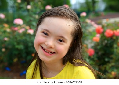 Young girl on the background of roses