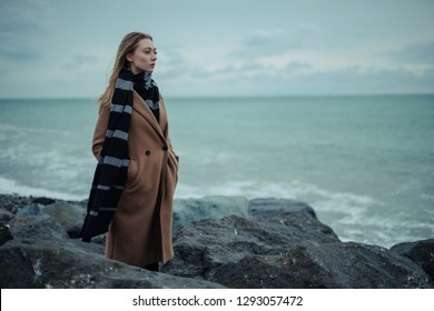 Young girl on the background of the winter sea.