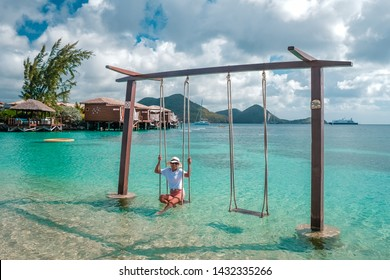 young girl on the beach of Saint Lucia, tropical Island in the Caribbean St Lucia, woman on the ebach watching the ocean on vacation, luxury hollidays