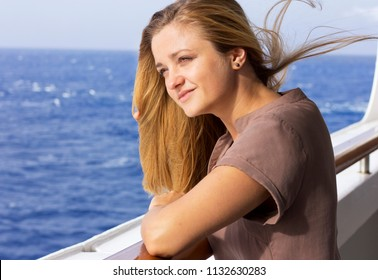 A young girl on a big liner. Beautiful girl in the open ocean. Rest on the sea. Seaside vacation. girl on the ship