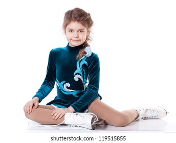 Young girl on figure skates isolated on a white background