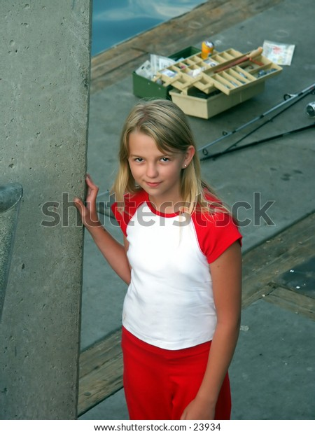 young girl on a fishing dock