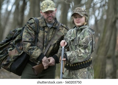 A young girl on the hunt with an experienced instructor in the forest. Autumn. Hunting for upland wildfowl.
