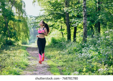 young girl on a morning workout in the park