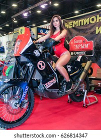 Young girl on motobike. St. Petersburg Russia - 15 April, 2017. International Motor Show IMIS-2017 in Expoforurum. Models on motorcycles presented at the motor show.
