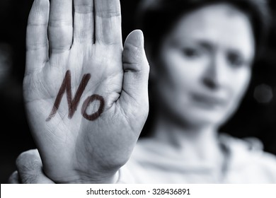 """The young girl on the palms of both hands with a red marker says  """"no."""""""