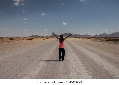 Young girl on a road trip around Namibia, Africa