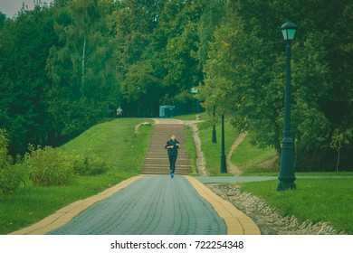 Young girl on a run in the early autumn morning