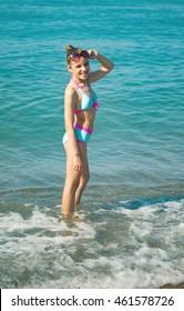 young girl on the sea coast