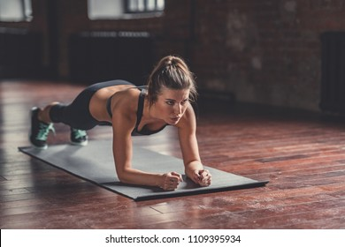 Young girl on sports training in the loft