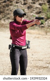 Young girl on tactical gun training classes. Woman with weapon. Outdoor Shooting Range