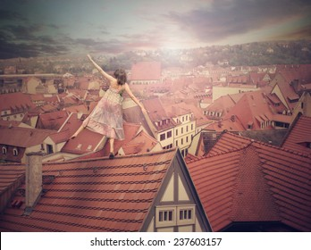 Young girl on top of the roof. Photo manipulation. Concept digital graphic