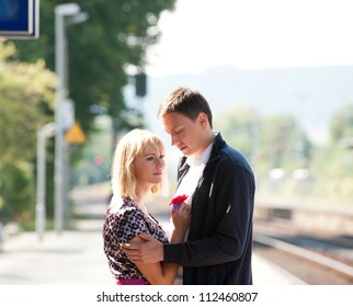 Young girl on train station says goodbye before catching her train