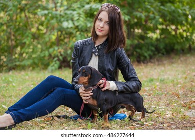 young girl on a walk with her dachshund