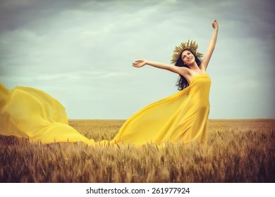 Young girl on wheat field, soft focus