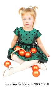 Young girl with ornaments not happy with her Christmas time. Shot in studio over white.