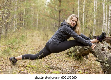 Young girl outdoors in the forest, engaged in shaping and posing in gym. The overall plan, Russia.