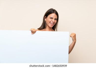 Young girl over isolated background holding an empty white placard for insert a concept