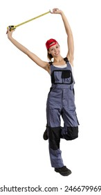 Young girl in overalls with a construction tape measure in hand. Isolated on white