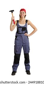 Young girl in overalls with a hammer in his hand. Isolated on white