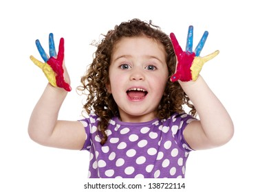 Young girl with paint on her hands and fingers smiling isolated on a white background