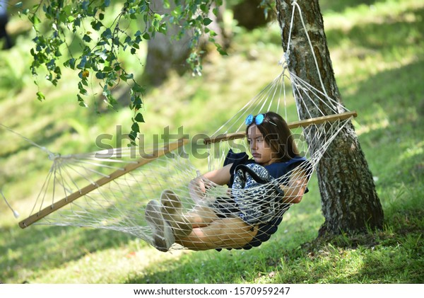 young-girl-park-resting-on-600w-15709592