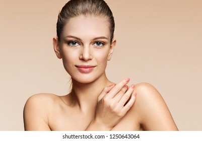 Young girl with perfect skin on beige background. Beauty & Skin care concept