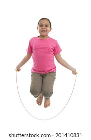 Young Girl Performing Rope Skipping Isolated on White Background