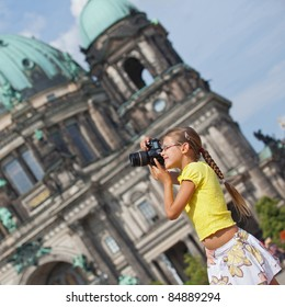 young girl with photo camera. Berlin background