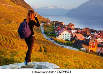 Young girl photographing the Vineyard terraces in the famous Lavaux wine region (UNESCO World Heritage Site since 2007) of Lake Geneva, Canton of Vaud, Switzerland