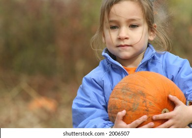 Young Girl Picks her Pumkin