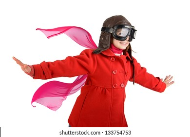 Young girl with pilot goggles and hat isolated in white