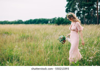 Young Girl In A Pink Dress In The Meadow